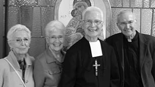 Br. Hugh (center) with two of his sisters, Elizabeth and Sr. Patricia, and his brother, Rev. Sean.