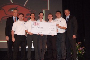 IDEA instructor Dan Gorsky (left) and Principal Larry Tucker (right) with Candoo, the top funded team at Marist's inaugural pitch night. Teams members are seniors Kenny Condon (from left), Kyle Gambla, Connor Mish, John Carroll, and Patrick Sweeney.