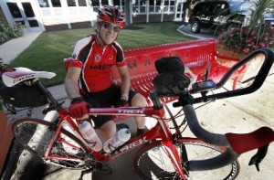 "Owen Glennon, a math teacher at Marist High School, 4200 W. 115th St., biked more than 1,000 miles this summer to raise money for the South Side school. ""It was an adventure, that's for sure,"" Glennon said of his 1,054.6-mile cycling odyssey from New York to Chicago.(Karen Callaway/Catholic New World)"